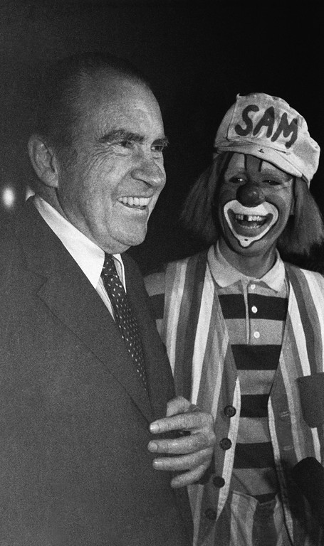 ". Former President Richard Nixon shares a laugh with ""Sam\"" the clown from the Ringling Brothers and Barnum and Bailey Circus, at the Brendan Byrne Arena on Nov. 26, 1982 in East Rutherford, New Jersey. Nixon was at the circus with his grandchildren. (AP Photo/David Bookstaver)"