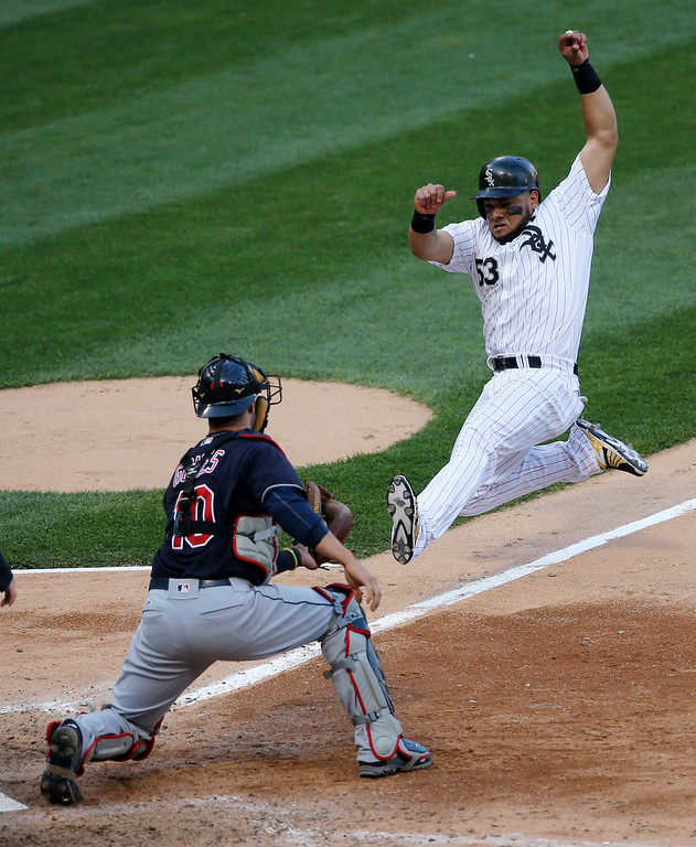 . Cleveland Indians catcher Yan Gomes, left, takes a throw from right fielder Michael Martinez and tags out Chicago White Sox\'s Melky Cabrera at home during the seventh inning of a baseball game Monday, May 23, 2016, in Chicago. (AP Photo/Charles Rex Arbogast)