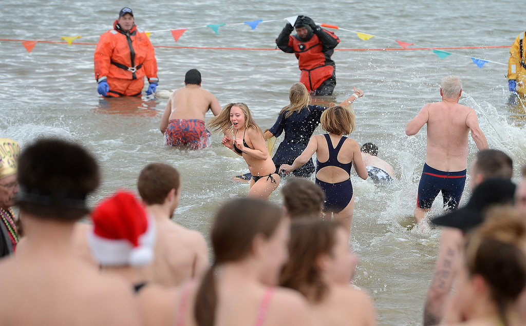 . Plungers line up to brave the water on Wednesday. The 31st annual Boulder Polar Plunge, at the Boulder Reservoir on New Year�s Day, to help the Boulder County AIDS Project and connectBCAP.  Cliff Grassmick/Daily Camera