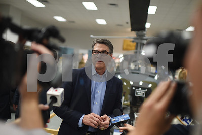 court-drops-1-charge-against-perry