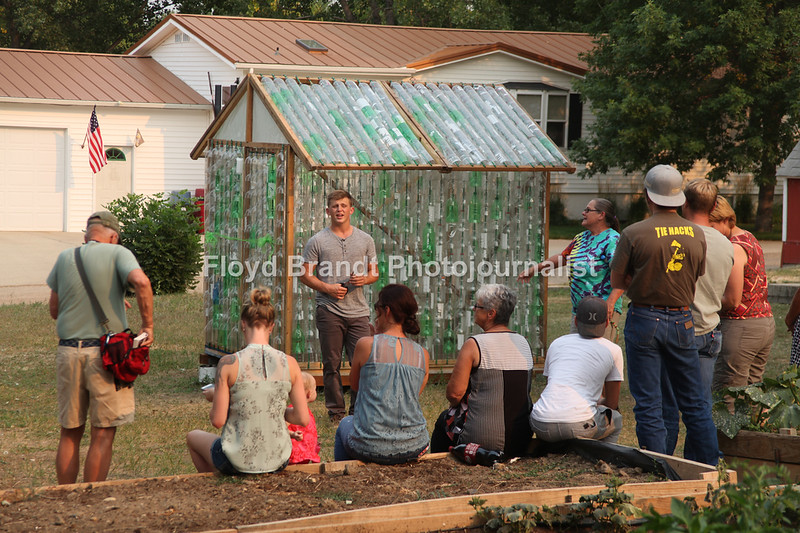 Havre Daily News/Floyd Brandt  Eagle Scout JJ Colby donated his scout project to the FFA Chinook Wednesday, JJ buildt a green house using recycled litter soda bottles.