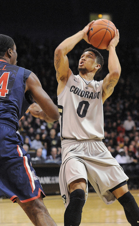. BOULDER, CO. - FEBRUARY 14: Colorado point guard Askia Booker (0) worked against Wildcats forward Solomon Hill (44) in the first half. The University of Colorado men\'s basketball team hosted Arizona Thursday night, February 14, 2013 at the Coors Event Center in Boulder. (Photo By Karl Gehring/The Denver Post)
