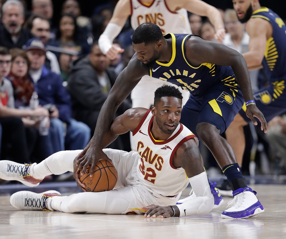 . Cleveland Cavaliers\' Jeff Green (32) and Indiana Pacers\' Lance Stephenson (1) go for the ball during the second half of an NBA basketball game, Friday, Jan. 12, 2018, in Indianapolis. (AP Photo/Darron Cummings)