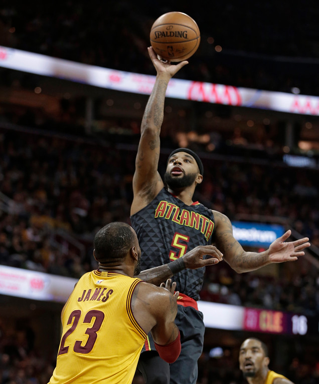 . Atlanta Hawks\' Malcolm Delaney (5) drives to the basket against Cleveland Cavaliers\' LeBron James (23) in the first half of an NBA basketball game, Friday, April 7, 2017, in Cleveland. (AP Photo/Tony Dejak)