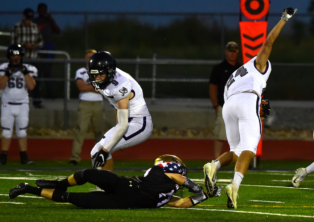 . BROOMFIELD CO - SEPTEMBER 14 2018 Holy Family High Jake Alderman trips up School\'s Discovery Canyon High\'s Ryan Monteleone during their game in Broomfield on Friday September 14, 2018. More photos bocopreps.com  (Photo by Paul Aiken/Staff Photographer)