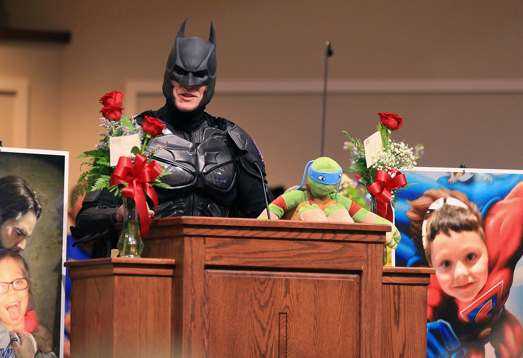 . John Buckland, of Huntington W.V., dressed as Batman, speaks during a superhero-themed funeral service for Jacob Hall at Oakdale Baptist Church on Wednesday, Oct. 5, 2016, in Townville, S.C. A 14-year-old boy killed his own father, then drove to Townville Elementary and fired on two children and a teacher as recess began. Jacob died Saturday. (Ken Ruinard/The Independent-Mail via AP, Pool)
