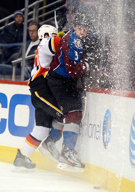 . DENVER, CO. - FEBRUARY 28: Dennis Wideman (26) of the Calgary Flames slams Shane O\'Brien (5) of the Colorado Avalanche in to the boards during the first period February 28, 2013 at Pepsi Center.(Photo By John Leyba/The Denver Post)