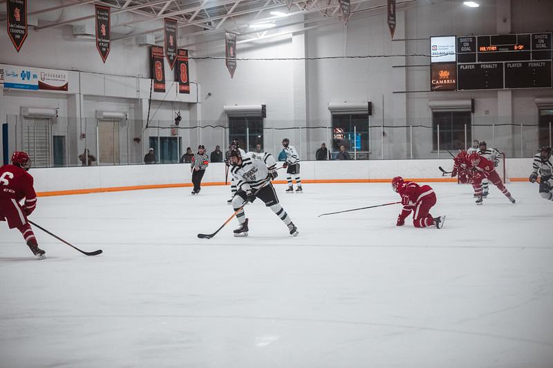 Holy Family Boys Varsity Hockey vs. Benilde-St. Margaret's, 12/26/19: Marc Lund '21 (15)