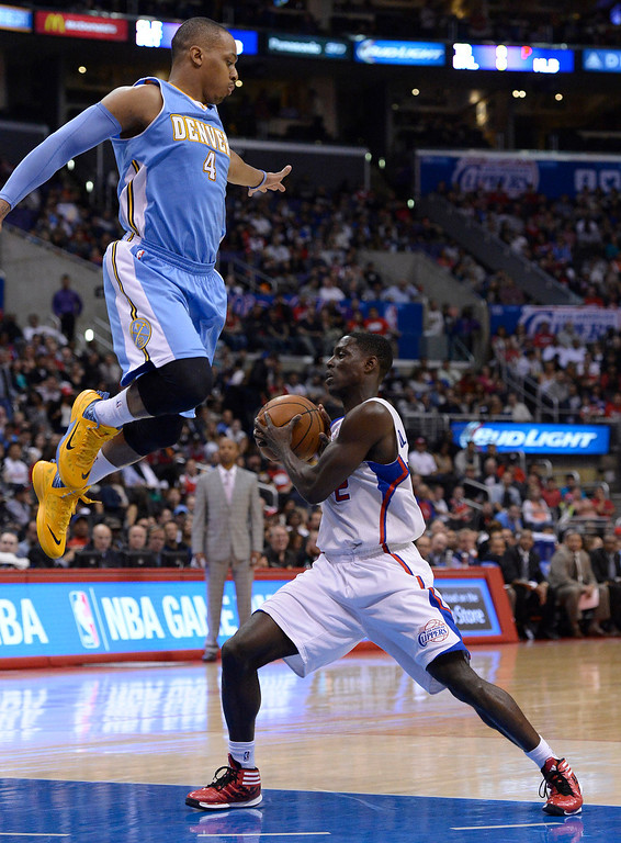 . Nuggets #4 Randy Foye was faked high into the air by Clippers#2 Darren Collison in the first half. The Los Angeles Clippers took on the Denver Nuggets in a regular season NBA game. Los Angeles, CA. 4/15/2014(Photo by John McCoy / Los Angeles Daily News)