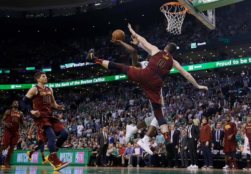 . Boston Celtics guard Jaylen Brown, rear, drives against the defense of Cleveland Cavaliers center Kevin Love during the second half in Game 2 of the NBA basketball Eastern Conference finals Tuesday, May 15, 2018, in Boston. (AP Photo/Charles Krupa)