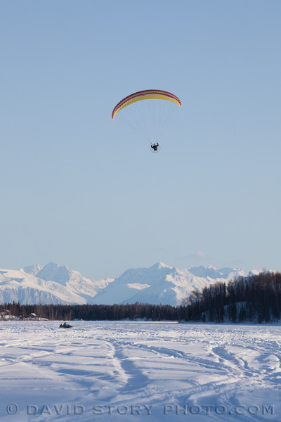 A powered parachute soars above Nancy Lake.
