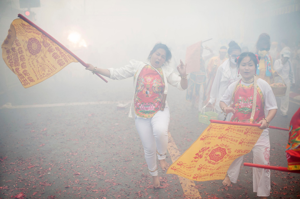. Vegetarian festival devotees of Jui Tui shrine parade through the streets as firecrackers go off on September 30, 2014 in Phuket, Thailand.  (Photo by Borja Sanchez-Trillo/Getty Images)