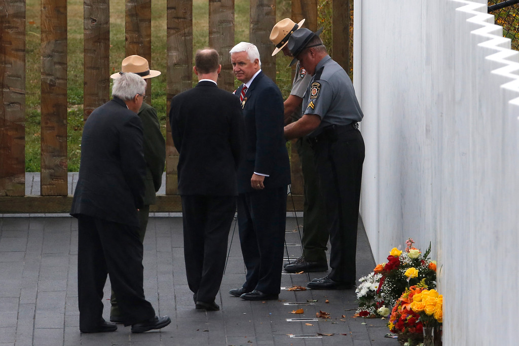 . Pennsylvania Governor Tom Corbett, center, helps to lay a wreath at the Wall of Names during a Service of Remembrance at the Flight 93 National Memorial in Shanksville, Pa., Thursday, Sept. 11,  2014. (AP Photo/Gene J. Puskar)