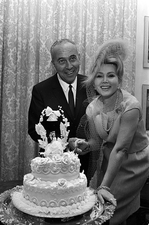 . Actress Zsa Zsa Gabor and industrialist Herbert Hutner cut thier wedding cake after getting married in New York, Nov. 5, 1962.  They had a civil ceremony.  (AP Photo)