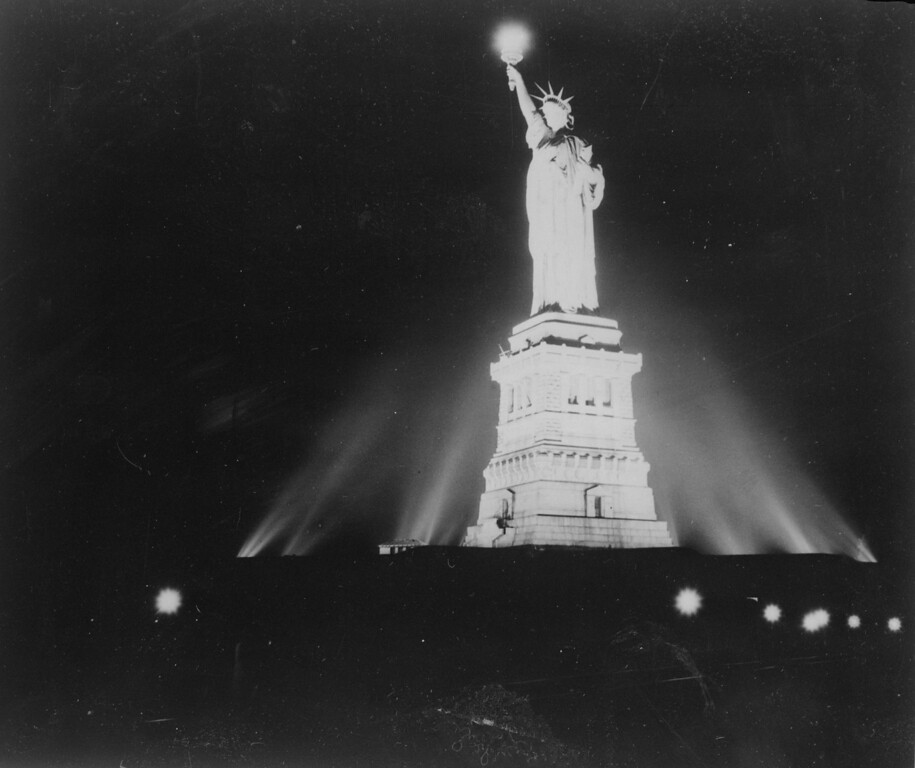 . The Statue of Liberty in New York, lit up for the first time since the attack on Pearl Harbor in 1945.  (Photo by Keystone/Getty Images)
