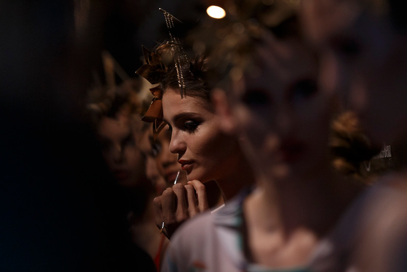 . A model gets her make up applied before displaying a Spring/Summer design by Dolores Cortes during the Madrid\'s Fashion Week in Madrid, Spain, Monday, Sept. 15, 2014 . (AP Photo/Daniel Ochoa de Olza)