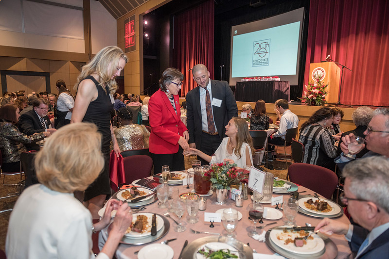 President Gayle Hutchinson greets guest as Distinguished Alumni are recognized during an evening dinner on Friday, March 9, 2018 in Chico, Calif.  (Jason Halley/University Photographer/CSU Chico)