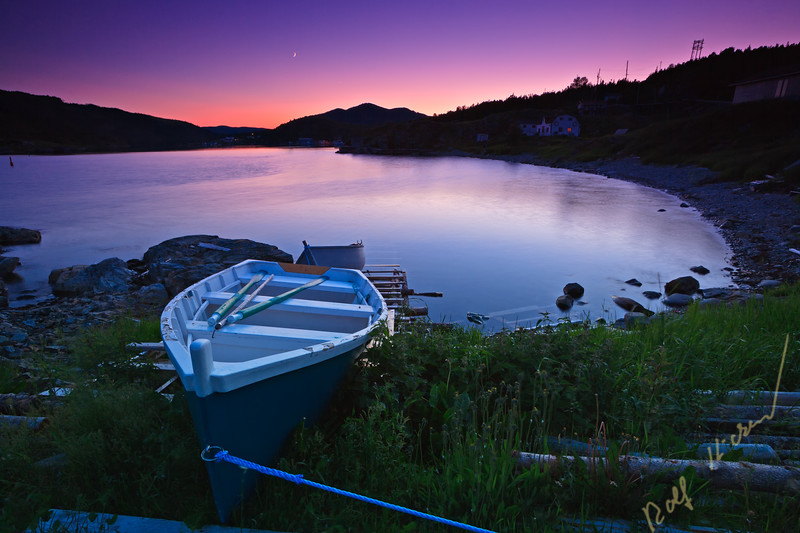 Boat hauled out on the banks at  sunset in the town of Fleur de Lys, Dorset Trail, Highway 410, Baie Verte Peninsula, Newfoundland, Newfoundland Labrador, Canada.