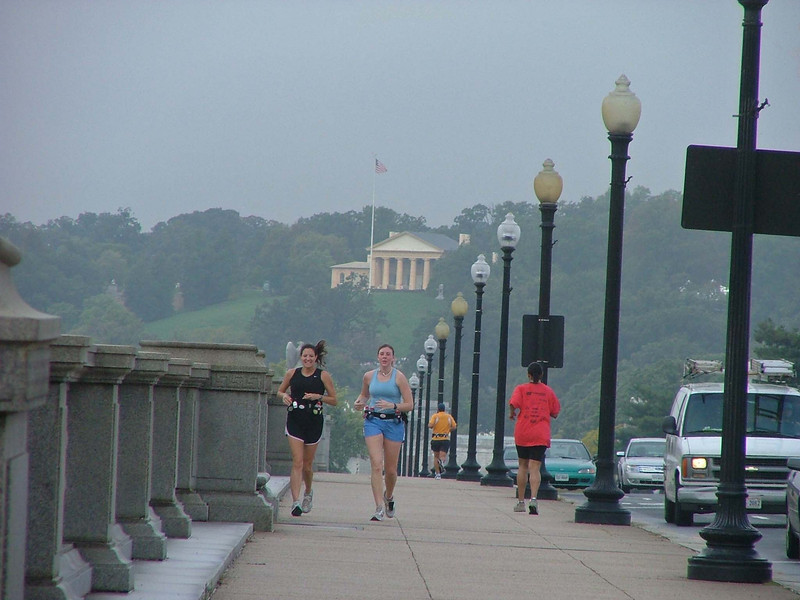 Joggers on Memorial Bridge, looking to Virginia, Arlington Cemetery and Tomb of the Unknown Soldier  http://www.arlingtoncemetery.net/tombofun.htm
