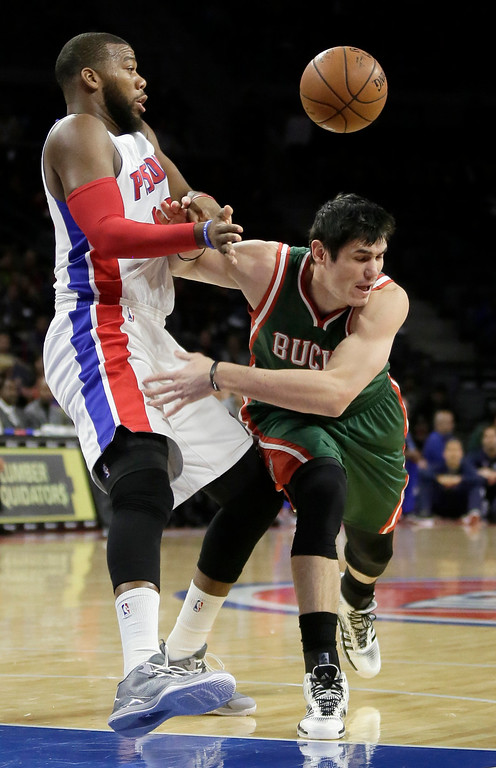 . Milwaukee Bucks\' Ersan Ilyasova, right, loses the ball after colliding with Detroit Pistons\' Greg Monroe, left, during the first half of an NBA basketball game Friday, Nov. 7, 2014, in Auburn Hills, Mich. (AP Photo/Duane Burleson)