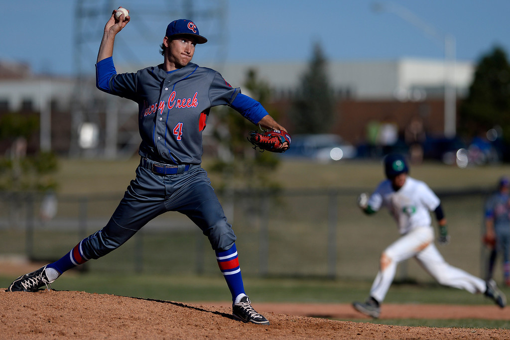 . Aurora, CO - APRIL 08: Cody Wood (4) of the Cherry Creek Bruins fires a pitch against the Overland Trailblazers during the fifth inning. Overland hosted Cherry Creek on Tuesday, April 8, 2014. (Photo by AAron Ontiveroz/The Denver Post)