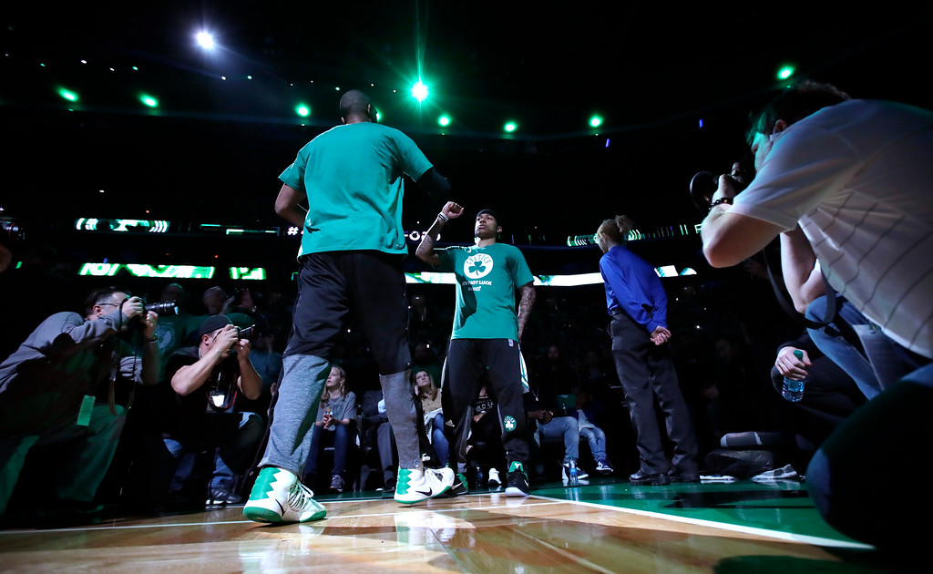 . Boston Celtics guard Isaiah Thomas (4) high-fives Al Horford before the first half of Game 7 of an NBA basketball second-round playoff series Boston, Monday, May 15, 2017. (AP Photo/Charles Krupa)