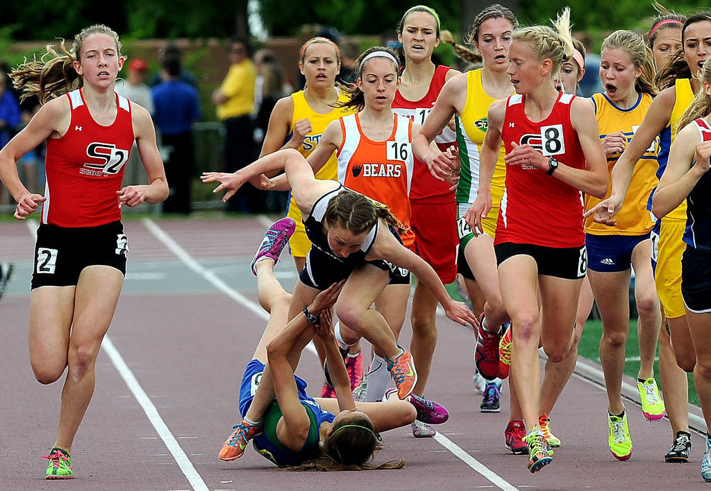 . Shakopee\'s Tess Misgen (2), left, and Maria Hauger, (8)  lead the pack as Bemidji\'s Jenna Truedson trips over Eagan\'s Danielle Anderson during the girls 1600 meters at the Minnesota State High School Class 2A Track and Field Championships on Saturday, June 8, 2013, at Hamline University in St. Paul. Truedson, after recovering from tripping, went on to win the race with a time of 4:59.75. (Pioneer Press: Sherri LaRose-Chiglo)