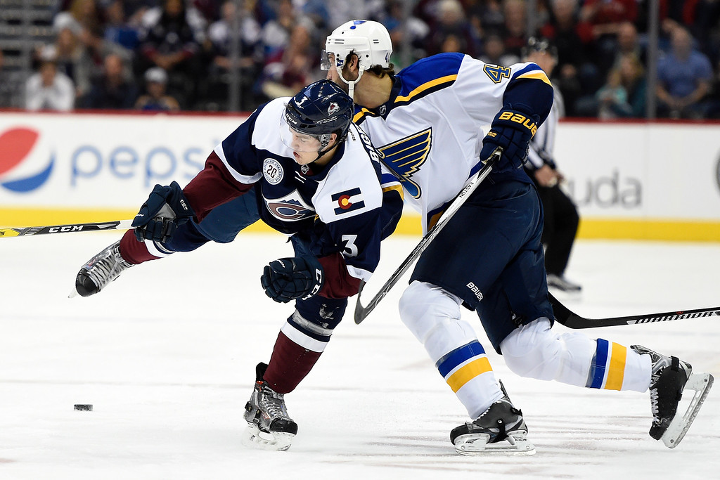 . DENVER, CO - APRIL 03: Robert Bortuzzo (41) of the St. Louis Blues bodies Chris Bigras (3) of the Colorado Avalanche jarring the puck loose during the first period. The Colorado Avalanche hosted the St. Louis Blues at the Pepsi Center on Sunday, April 3, 2016. (Photo by AAron Ontiveroz/The Denver Post)