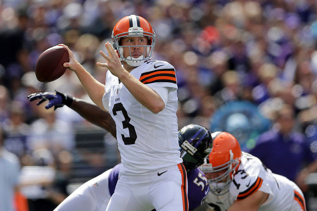 . Cleveland Browns quarterback Brandon Weeden looks for an open man during the first half of an NFL football game against the Baltimore Ravens in Baltimore, Md., Sunday Sept. 15, 2013. (AP Photo/Patrick Semansky)