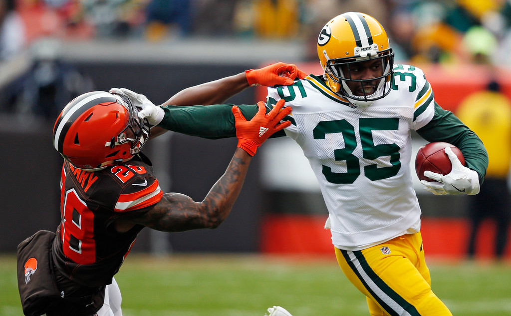 . Green Bay Packers free safety Jermaine Whitehead (35) holds off Cleveland Browns defensive back Darrius Hillary (28) for a first down in the first half of an NFL football game, Sunday, Dec. 10, 2017, in Cleveland. (AP Photo/Ron Schwane)