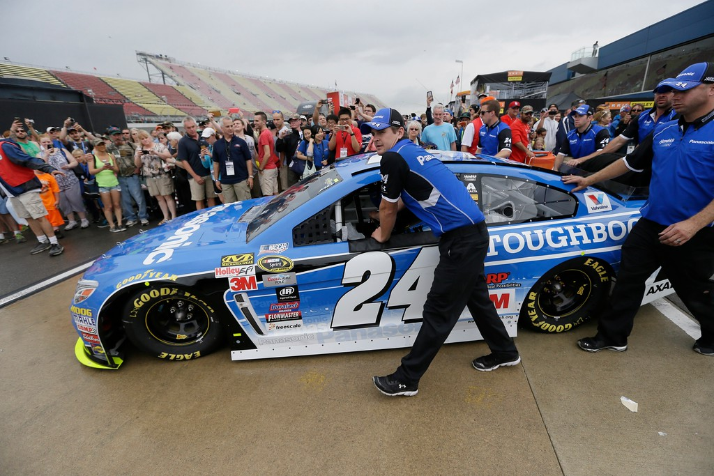 . Jeff Gordon\'s car is rolled onto pit row before the NASCAR Sprint Cup series auto race at Michigan International Speedway, Sunday, June 14, 2015, in Brooklyn, Mich. (AP Photo/Carlos Osorio)