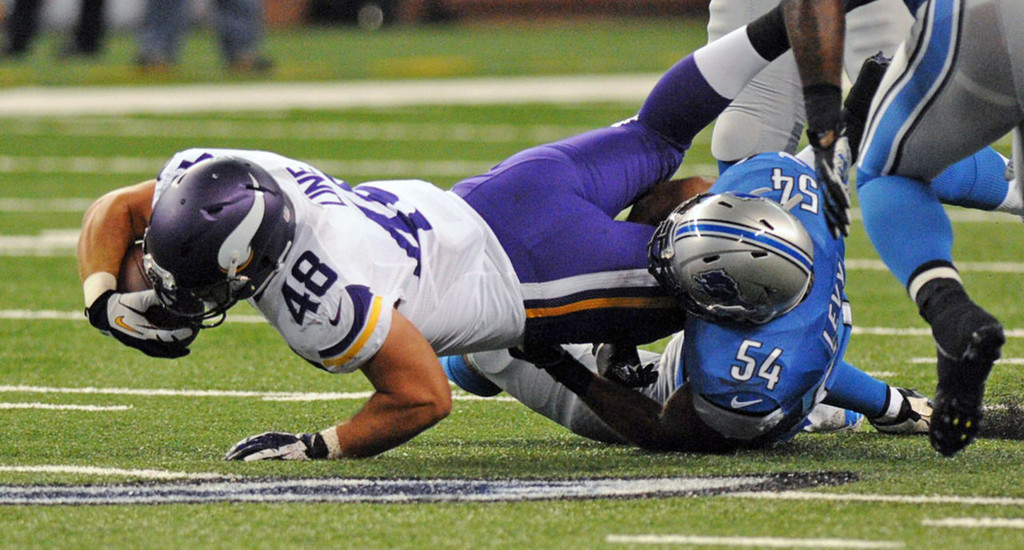 . Vikings running back Zach Line is tackled by Lions outside linebacker DeAndre Levy after a reception in the second quarter.  (Pioneer Press: Chris Polydoroff)