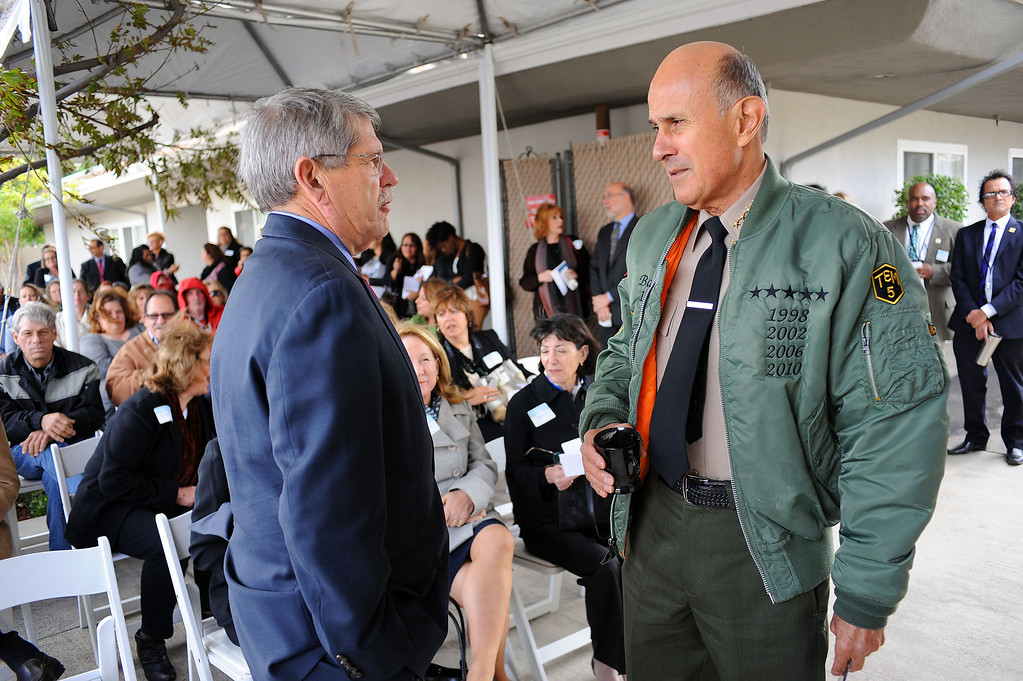 . LA County Supervisor Zev Yaroslavsky chats with Sheriff Lee Baca during a ribbon cutting ceremony for the recently completed Zev Yaroslavsky Family Wing of Didi Hirsch\'s Via Avanta facility in Pacoima, CA Novemeber 22, 2013. The 6,524-square-wing has 9 rooms and is Los Angeles County\'s first rapid re-housing program devoted exclusively to homeless women with serious mental illness and their children.(Andy Holzman/Los Angeles Daily News)