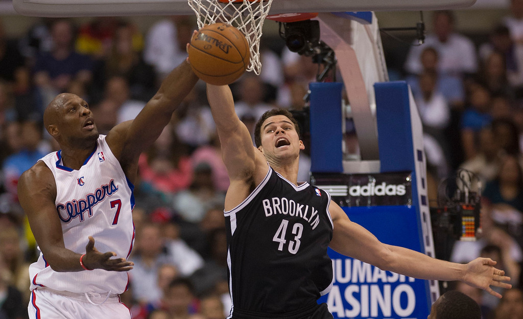 . The Clippers\' Lamar Odom #7 and the Nets\' Kris Humphries #43 battle for a rebound during their game Saturday, March 23, 2013 at the Staples Center in Los Angeles. (Hans Gutknecht/Los Angeles Daily News)