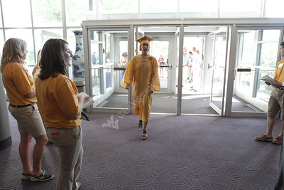 2. Walking into Coliseum/CAC/Event Center with family.