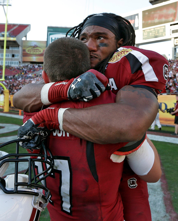 . South Carolina running back Kenny Miles (31) celebrates with quarterback Dylan Thompson (17) after they defeated Michigan 33-28 in the Outback Bowl NCAA college football game, Tuesday, Jan. 1, 2013, in Tampa, Fla.  (AP Photo/Chris O\'Meara)