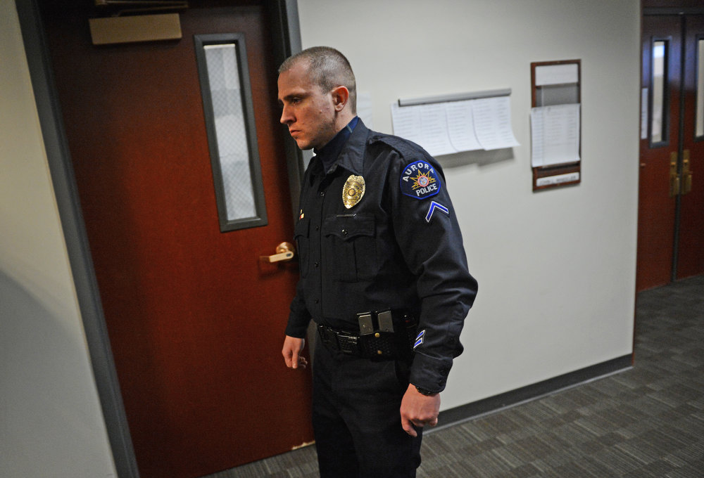 . Aurora Police Officer Justin Grizzle walks back to the court room, Monday, January 7, 2013, in Centennial. RJ Sangosti, The Denver Post