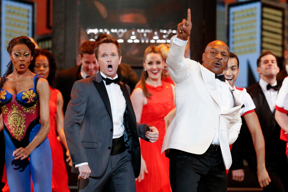 . Host Neil Patrick Harris and retired boxer Mike Tyson perform during the opening number of American Theatre Wing\'s annual Tony Awards in New York June 9, 2013. REUTERS/Lucas Jackson