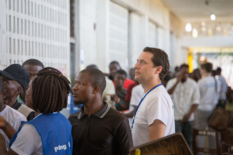 Monrovia, Liberia October 10, 2017 -  Jason Carter stands outside of a voting room on election day.