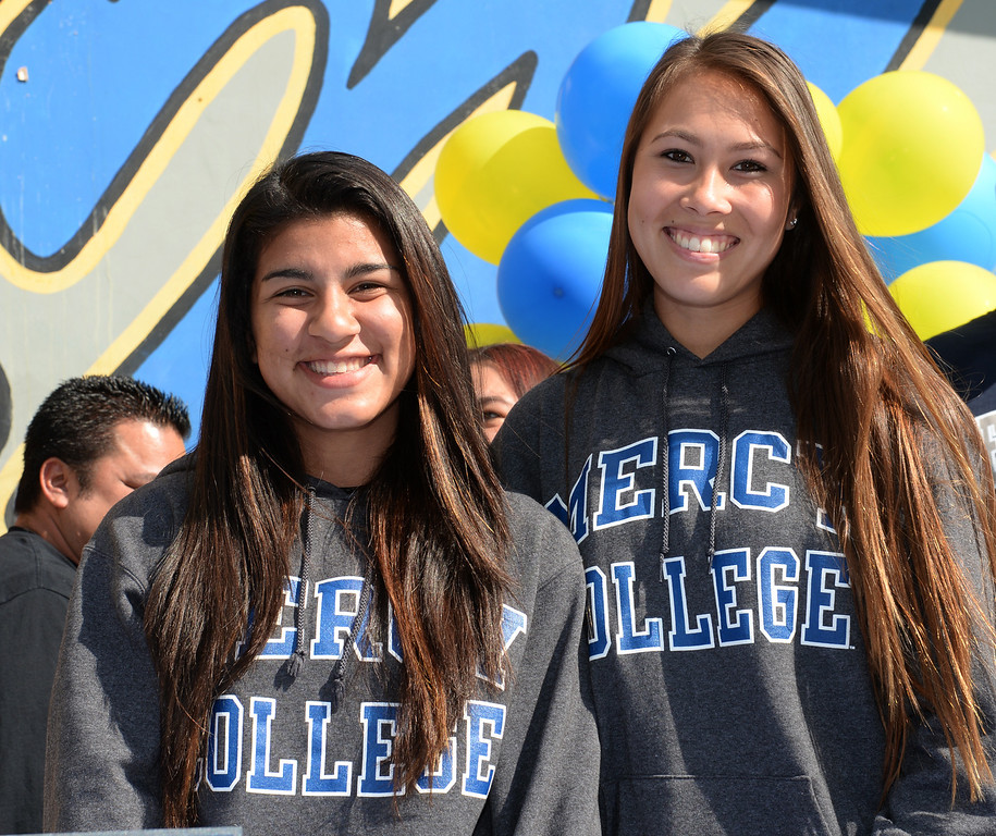 . Girls Soccer players Ileen Mejia, left, and Samantha Scovel, after signing their letters of intent to attend Mercy College during National Signing Day at La Mirada High School on Wednesday February 5, 2014. (Staff Photo by Keith Durflinger/Whittier Daily News)