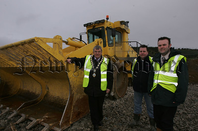 New Landfill Compactor at Aughnagun. Mayor Michael carr is pictured with Roland Moore, Waste Management Officer and Martin O'Hanlon Landfill site Ganger at Aughnagun landfill site. 07W8N6