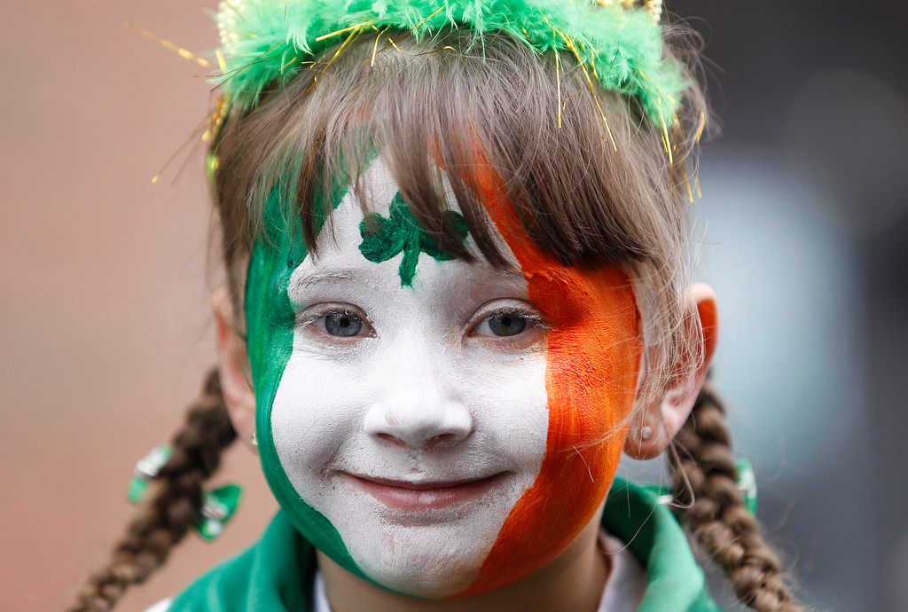 . A girl participates in St Patrick\'s day celebrations as she waits for a parade in the center of Belfast, Northern Ireland, Tuesday, March 17, 2015. (AP Photo/Peter Morrison)