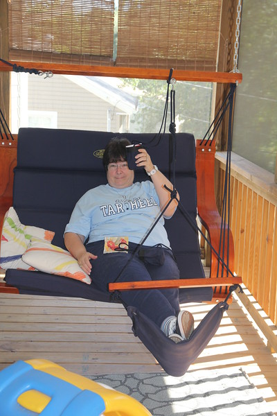 Joyce chillaxing in the Cerne Asheville MereFest porch swing