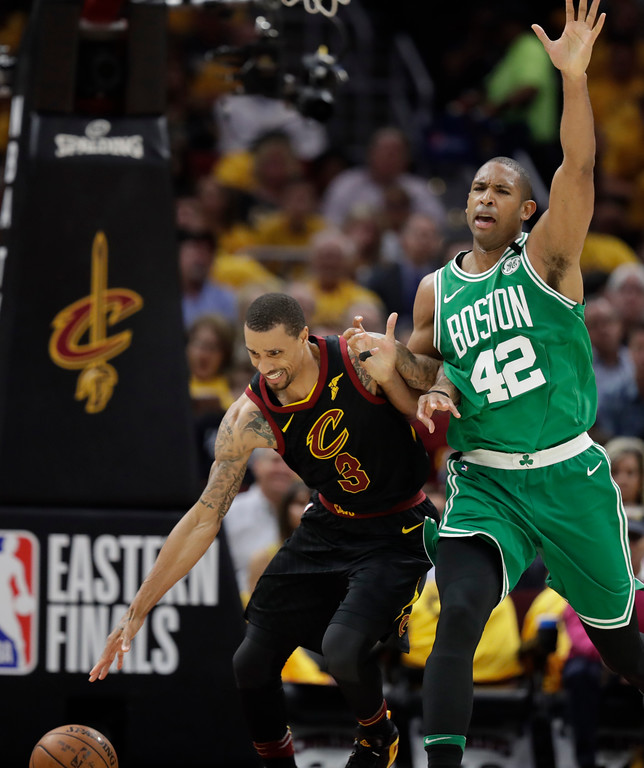 . Cleveland Cavaliers\' George Hill (3) controls the ball as Boston Celtics\' Al Horford (42) defends in the first half of Game 3 of the NBA basketball Eastern Conference finals, Saturday, May 19, 2018, in Cleveland. (AP Photo/Tony Dejak)