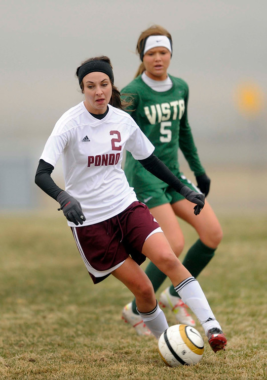 . Mustangs midfielder Emily Ostrander (2) worked with the ball in the second half. The Mountain Vista High School girl\'s soccer team defeated Ponderosa 6-0 Tuesday night, April 2, 2013.  Photo By Karl Gehring/The Denver Post)