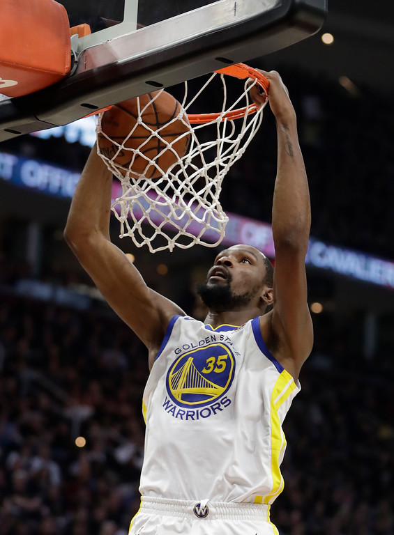 . Golden State Warriors\' Kevin Durant dunks during the first half of Game 4 of basketball\'s NBA Finals against the Cleveland Cavaliers, Friday, June 8, 2018, in Cleveland. (AP Photo/Tony Dejak)