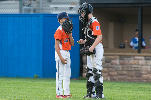 08/29/19 Wesley Bunnell | Staff The McCabe-Waters Astros vs the Forrestville Dodgers 3-0 at Breen Field on in the final game on Thursday night at Breen Field for the City Series championship. Chase Dauphnee (4) talks strategy with catcher Lincoln Bashaw (11).