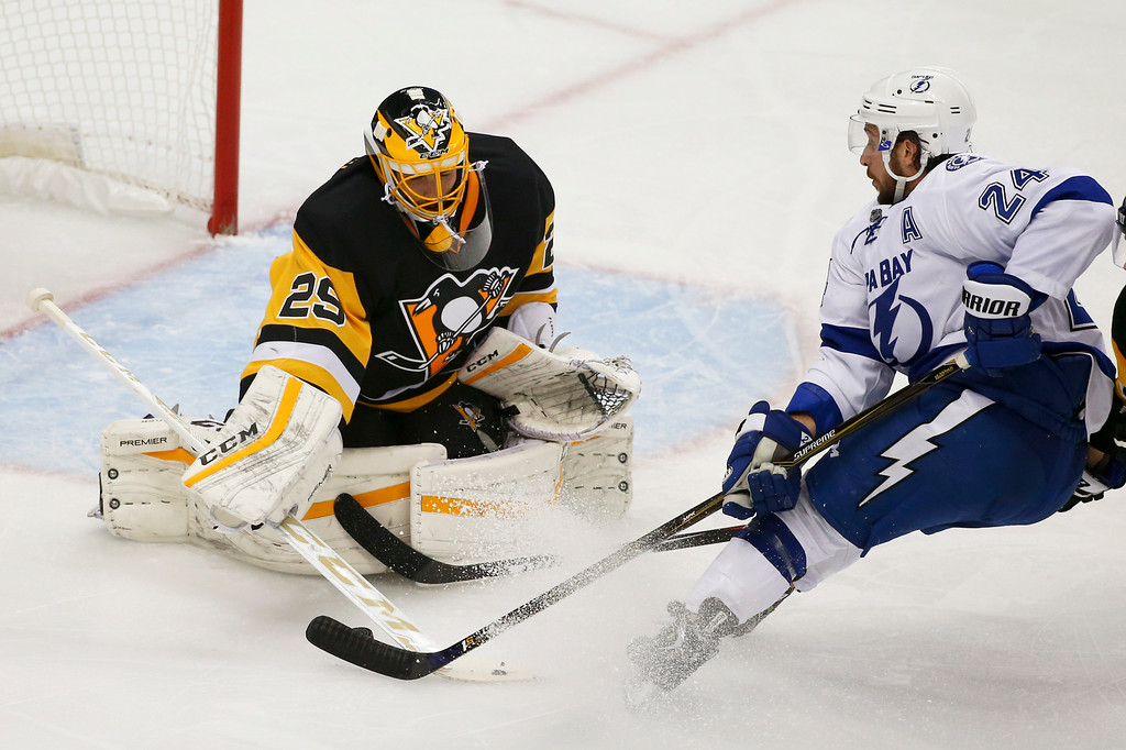 . Pittsburgh Penguins goalie Marc-Andre Fleury (29) makes a save on Tampa Bay Lightning\'s Ryan Callahan (24) during the first period of Game 5 of the NHL hockey Stanley Cup Eastern Conference finals, Sunday, May 22, 2016, in Pittsburgh. Fleury got his first start of the playoffs. (AP Photo/Gene J. Puskar)