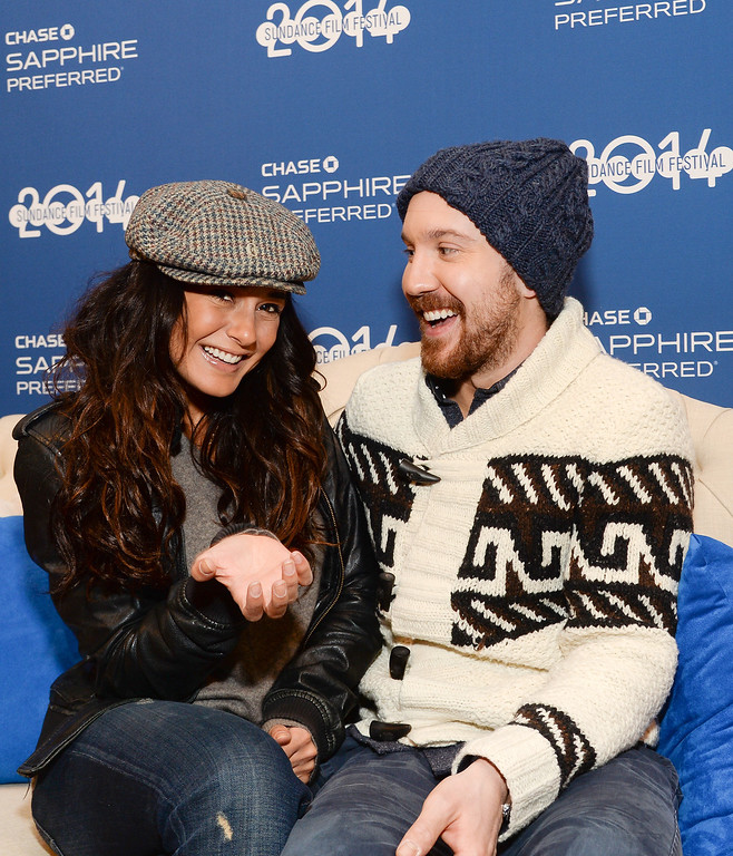 """. Actors Emmanuelle Chriqui, left, and Sam Huntington from the film \""""Three Night Stand\"""" visit Chase Sapphire on Main Street during the Sundance Film Festival on Monday, Jan. 20, 2014 in Park City, Utah. (Photo by Evan Agostini/Invision for Chase Sapphire Preferred/AP Images)"""