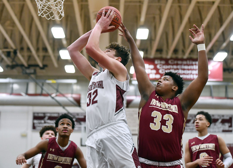 1/3/2020 Mike Orazzi   Staff Bristol Central High School's Donovan Clingan (32) and New Britain's Dontay Bishop (33) during Friday night's boys basketball game in Bristol.